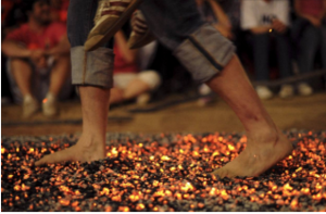 mind-over-matter-man-walking-on-hot-coals