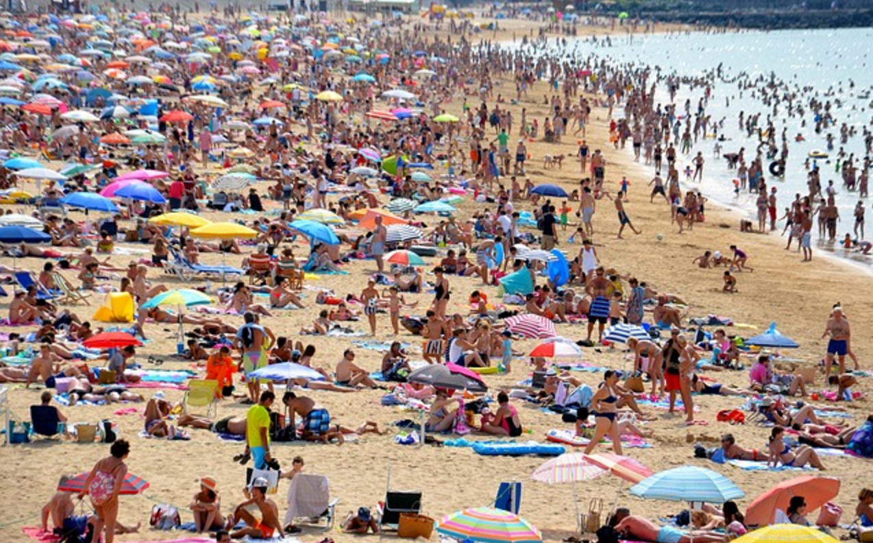 human-population-growth-crowded-beach